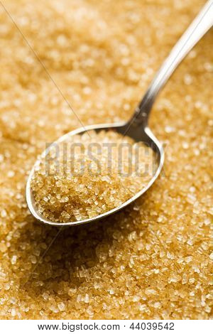 the brown sugar in silver spoon