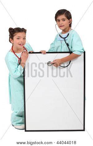 Brother and sister dressed as doctors