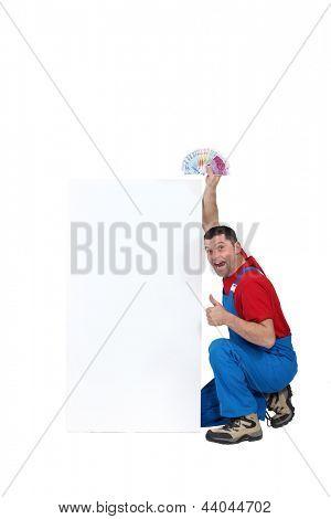 A handyman holding cash