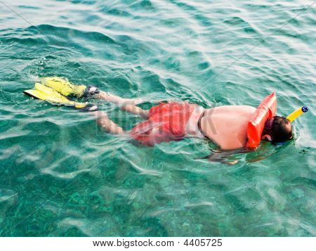Man In The Life Vests Snorkeling