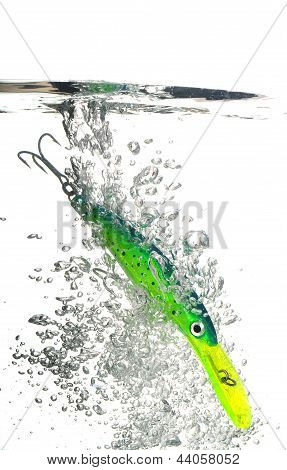 Green Lure Making A Splash In Water On White Background