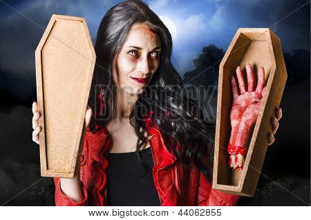 Female Halloween Zombie Holding Undead Hand