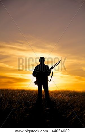 Woman Hunter in Sunset