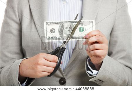 Business Concept With Dollars And Scissors