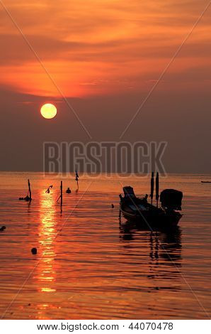 Sunset With Boat On Tropical Beach