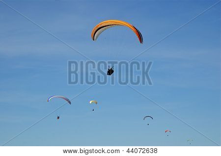 Formation Of Six Hang-Gliders in Sky