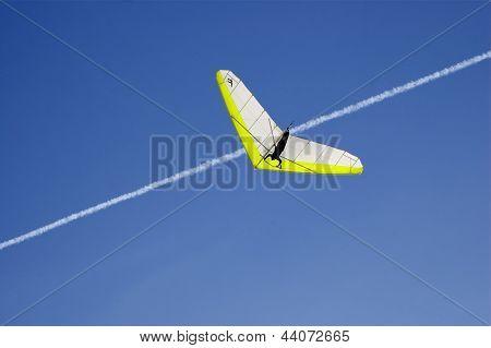 Hang Glider Against Deep Blue Sky