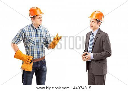 Male manual worker having a conversation with architect, isolated on white background