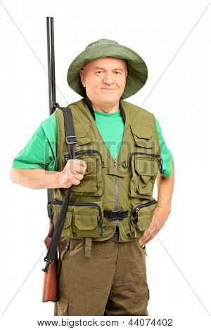 A mature hunter holding a rifle and looking at camera isolated on white background