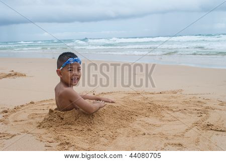 Playful Boy On The Beach With Sea  On Background At Phuket Island,thailand