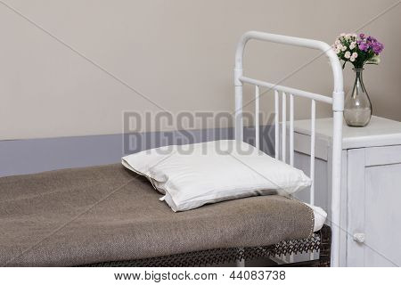 Hospital bed in chamber