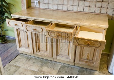 Kitchen Shelf With Opened Drawers