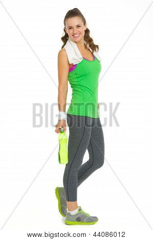 Full Length Portrait Of Happy Fitness Young Woman With Bottle Of