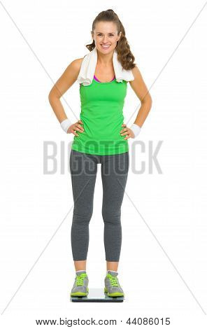 Full Length Portrait Of Happy Fitness Young Woman Standing On Sc