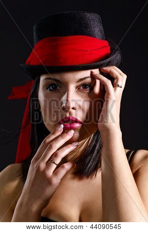 Woman In Black Hat With Red Scarf
