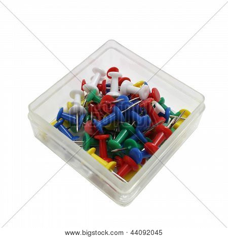 Colored Drawing Pins In A Transparent Box Isolated On White Background