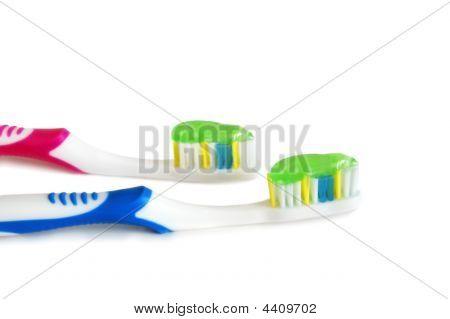 Escovas de dentes com pasta de dentes