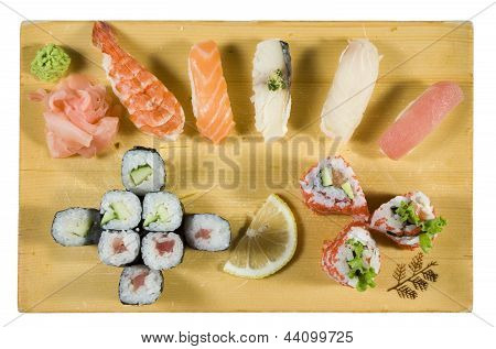 Japan foods on wooden plate isolated on white