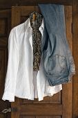 Jeans Blouse And Scarf On Antique Closet