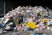 stock photo of waste management  - rubbish piled up at a waste management centre - JPG