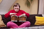 image of physically handicapped  - Mentally disabled woman enjoys her music therapy - JPG