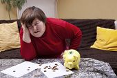 stock photo of physically handicapped  - handicapped woman look desperate in front of her bills - JPG