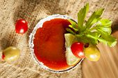 pic of bloody mary  - Spicy Bloody Mary Alcoholic Drink with a tomato garnish - JPG