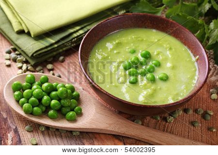 Green pea soup in bowl