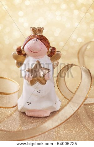 Christmas angel on golden background