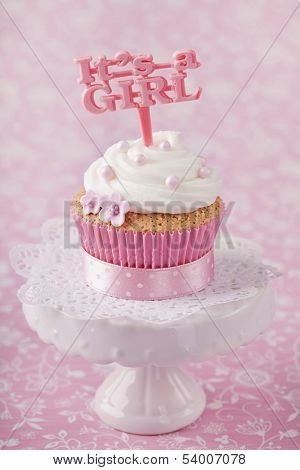 Cupcake with a cake pick on a stand