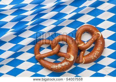Bretzels on a blue checkered fabric background