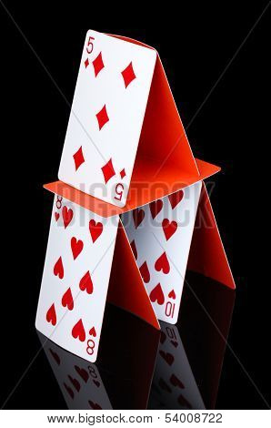 Card house isolated on black