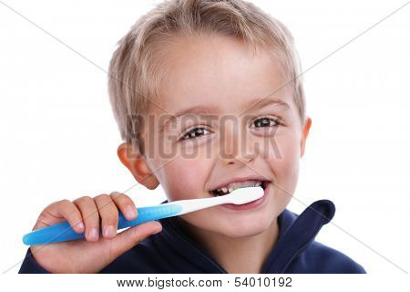 Boy child with toothbrush brushing teeth at bedtime concept for dental care