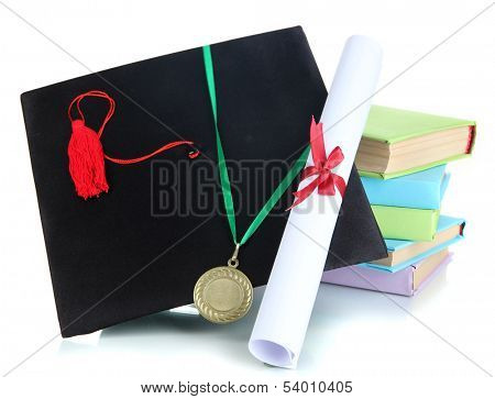 Medal for achievement in education with diploma, hat and books isolated on white
