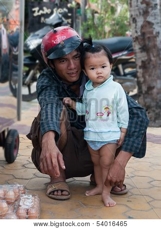 Vietnamese Man With His Daughter. Mui Ne. Vietnam