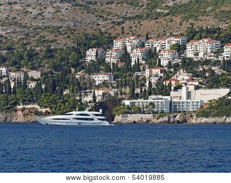 South Of Dubrovnik , Crotia, Yacht With Coastline In The Background