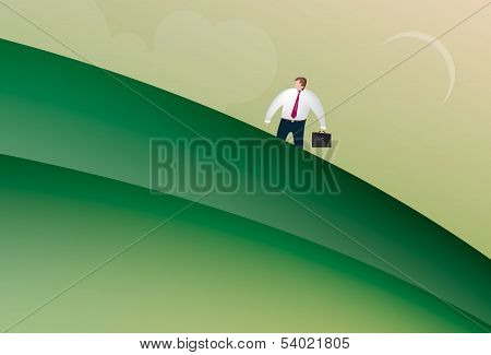 Business man walking up a hill