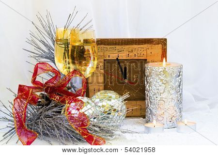 Christmas Composition With Clock, Glasses And A Thick Silver Candle...