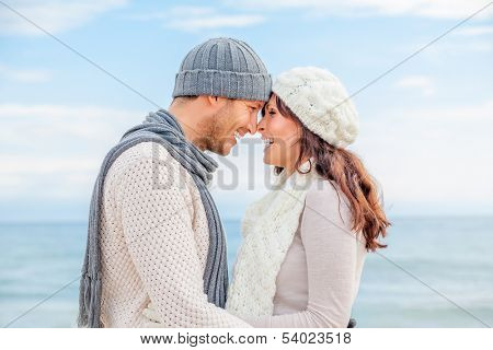 happy winter relaxing couple on the coast kissing