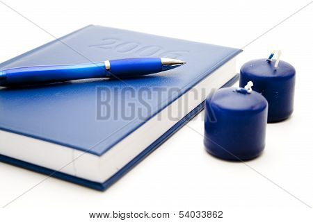 Notebook with pencil and candles