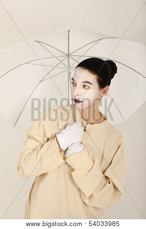 The Clown Holding A White Umbrella In Hand