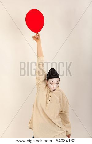 The Clown Is Playing With Red Balloons