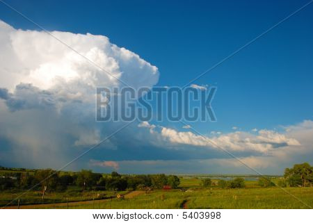 Thunderhead Towers Over A Pastoral Scene