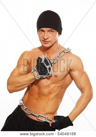 Handsome muscular man in beanie hat with chain