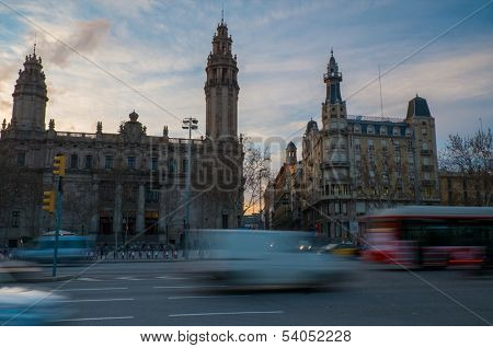 Fast moving cars against postal and telegraph building in Barcelona