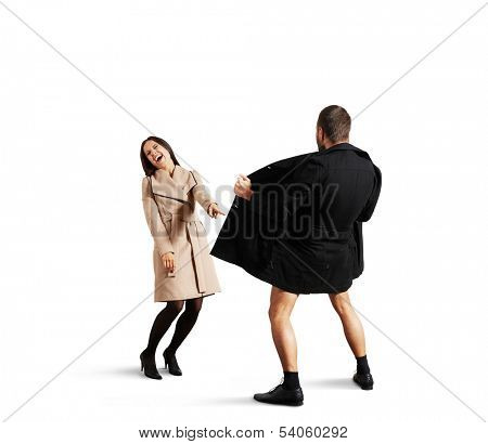 young woman laughing at the exhibitionist man. isolated on white background