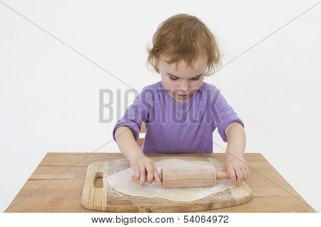 Cute Curly Child Rolling Out Dough