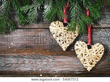 Christmas Fir Tree With Christmas Decorations On The Wooden Background