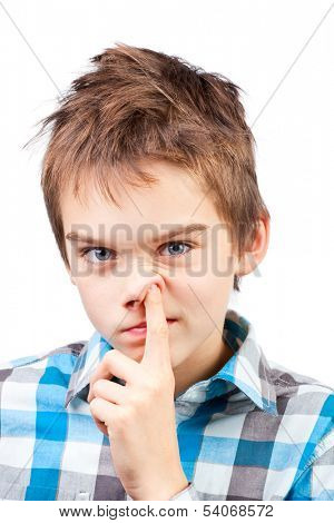 Portrait of a boy picking his nose