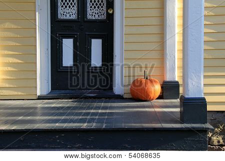Big orange pumpkin at country home's doorstep